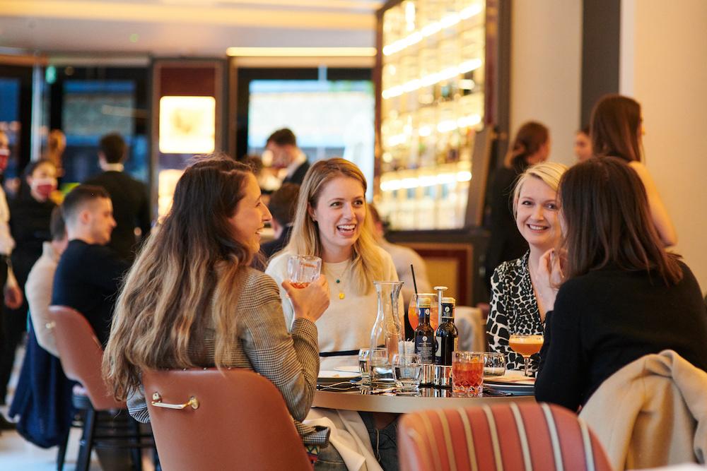 Smiling girls dining