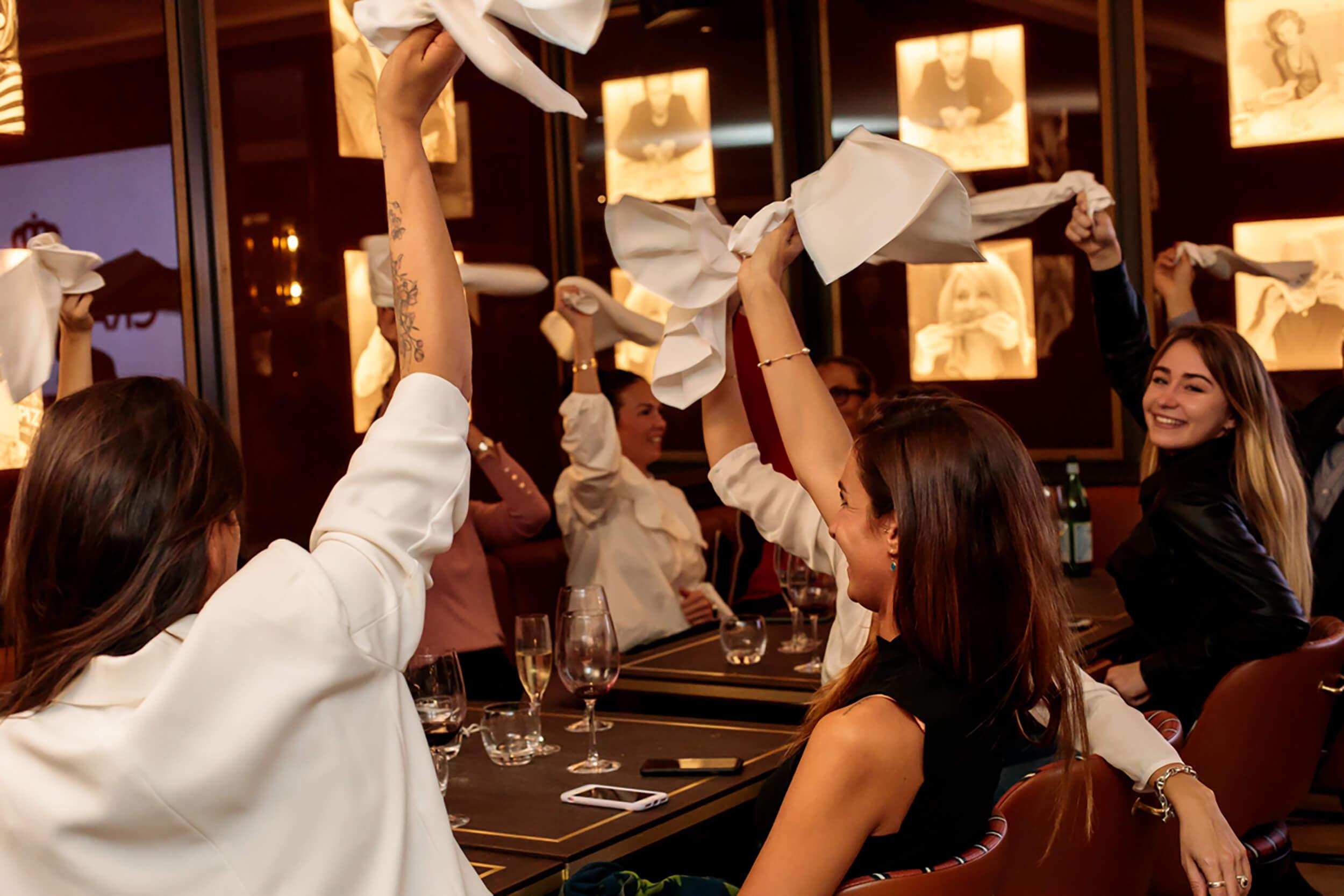 Guests swinging napkins.