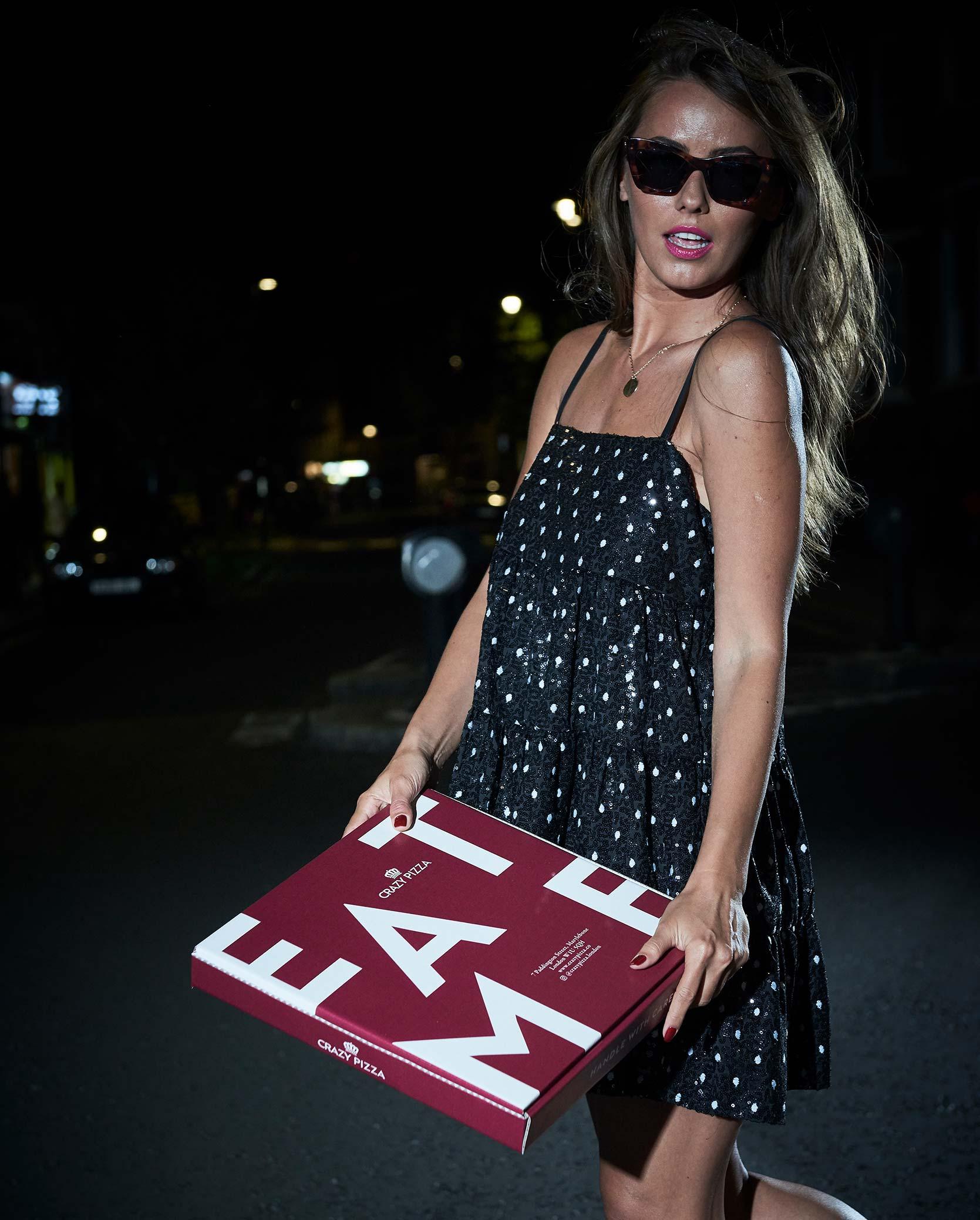 Woman holding a takeaway box