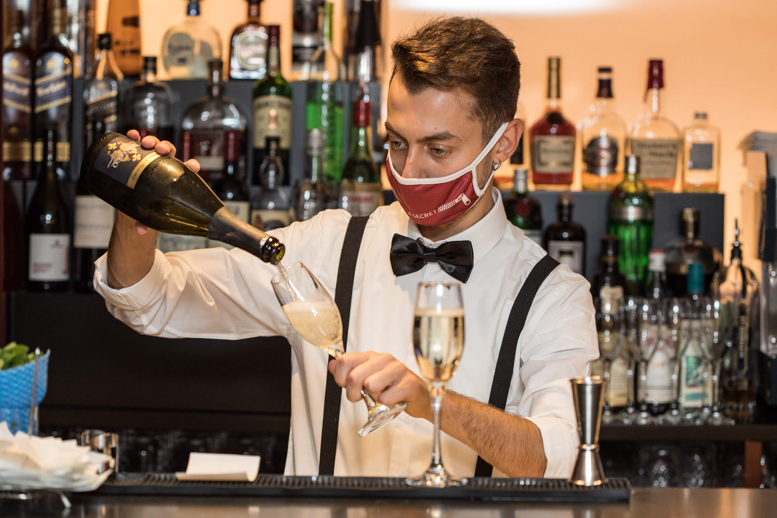 Bartender serving champagne.
