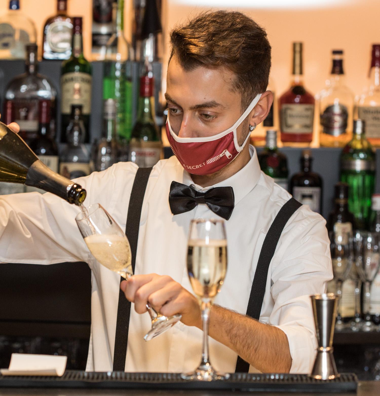 Bar man pouring prosecco