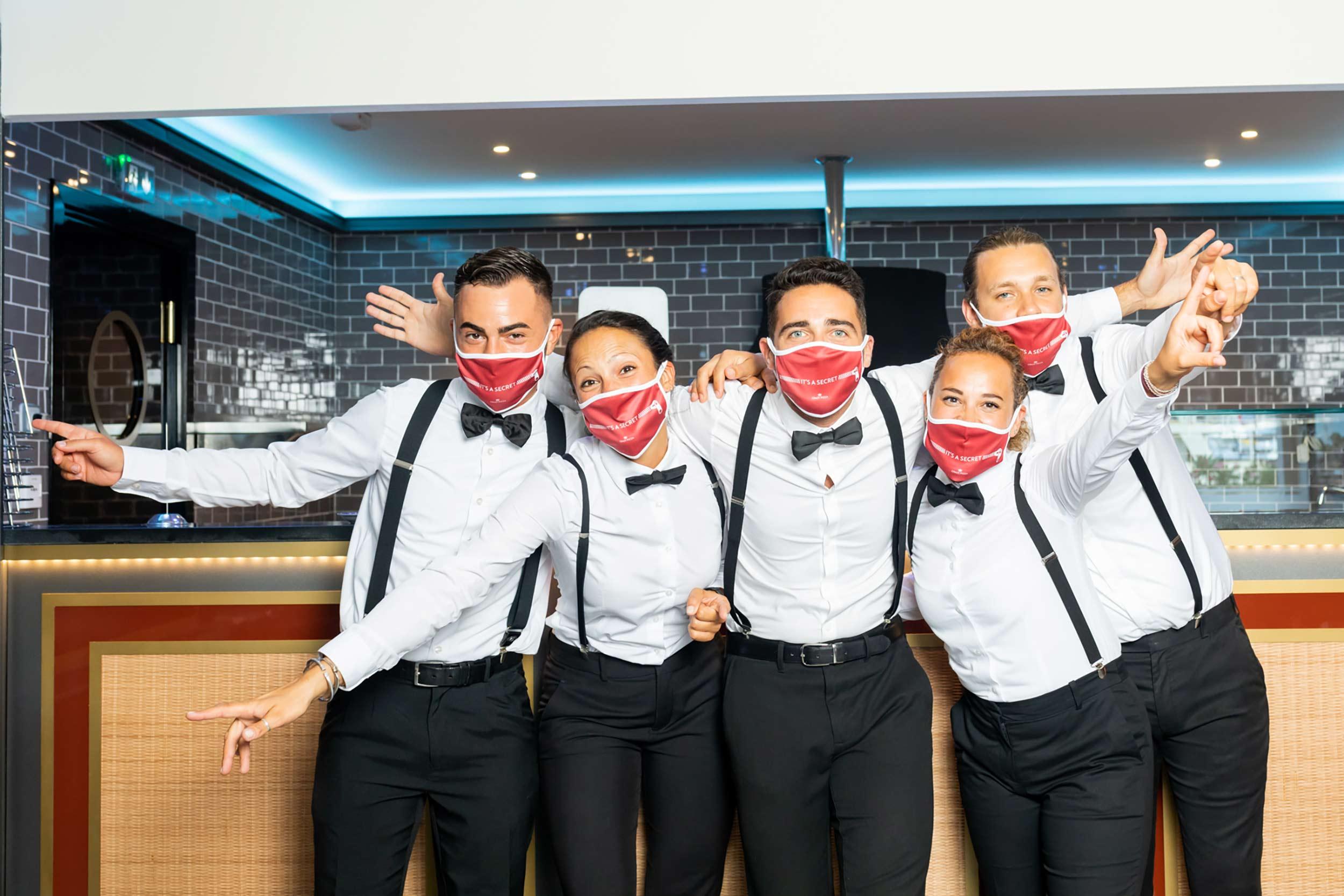 Group photo of waiters.